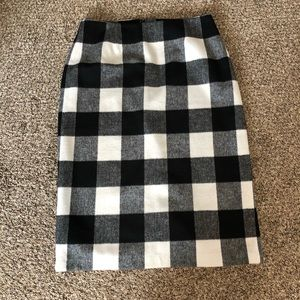 Black and white checkered skirt.